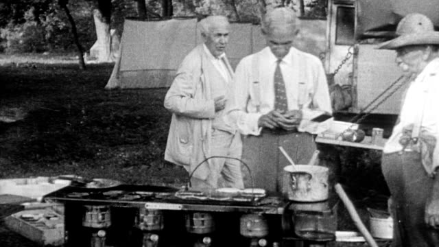 henry ford washing clothes by a stream cooking at a grill and camping with thomas edison in maryland 1920 - anno 1920 video stock e b–roll
