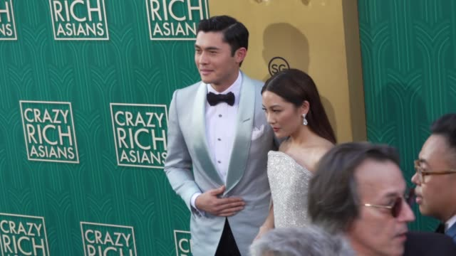 Henry Golding and Constance Wu at the Crazy Rich Asians Premiere at TCL Chinese Theatre on August 07 2018 in Hollywood California
