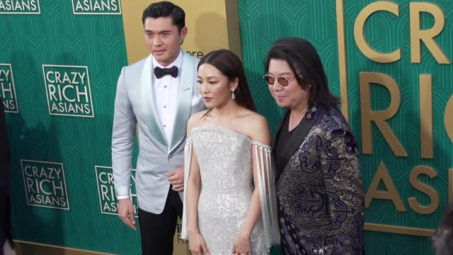 Henry Golding Constance Wu and Kevin Kwan at the Crazy Rich Asians Premiere at TCL Chinese Theatre on August 07 2018 in Hollywood California