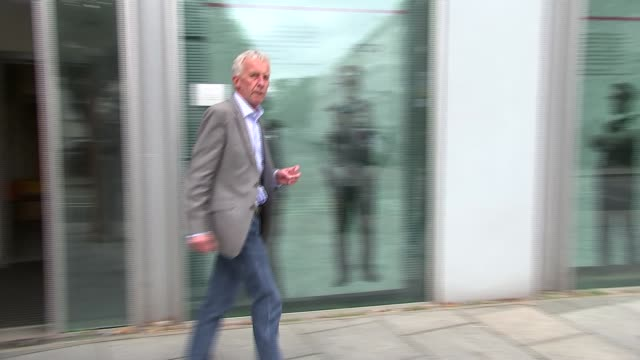 inquest departures ENGLAND London Earl's Court Empress State Building EXT David Hicks out of inquest building / women along from building