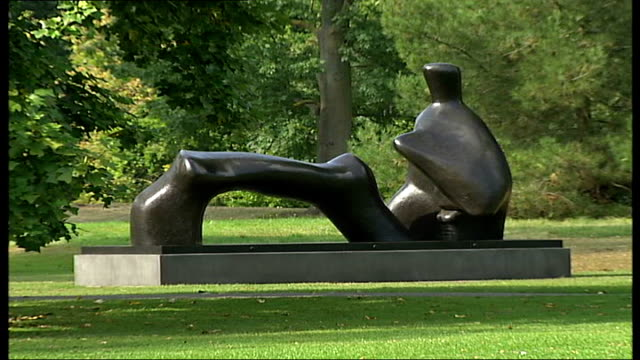 Henry Moore exhibition at Kew Gardens * * Music composed by Brian Eno overlaid on the following shots SOT * * Henry Moore sculpture 'Oval with...