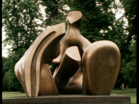 henry moore exhibition; england: london: kensington gardens: ext gv one sculpture, pull out to second bronze another third bronze work cms couple... - henry moore stock videos & royalty-free footage