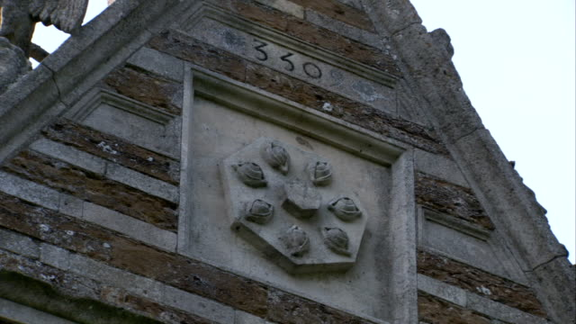 a heptagonal stone plaque adorns the side of rushton triangular lodge in northamptonshire, england. available in hd. - northamptonshire stock videos & royalty-free footage