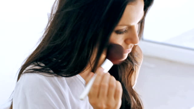 her beauty enhancing routine - blusher make up stock videos and b-roll footage