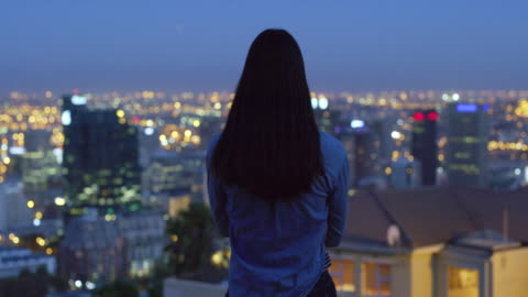 her heart burns for the city lights - cityscape stock videos & royalty-free footage