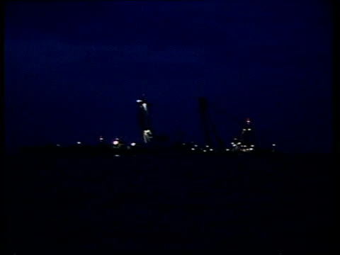 herald of free enterprise ferry disaster: salvage; belgium: zeebrugge harbour: int cms cmdr jack birkett interview sof ext / dark lms zoom in... - floodlit stock videos & royalty-free footage