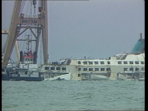 stockvideo's en b-roll-footage met salvage belgium zeebrugge jack birkitt interview sof ext ls zoom in crane barge next to ferry team of technical experts on superstructure lms crane... - zeebrugge