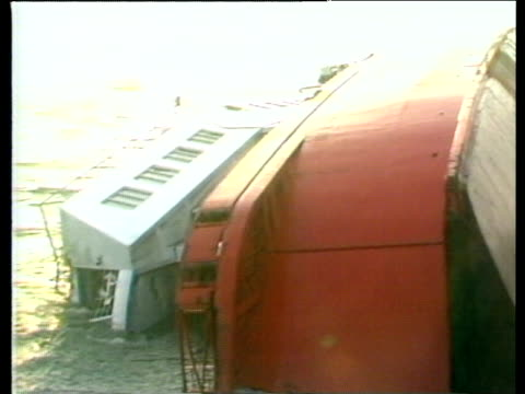 stockvideo's en b-roll-footage met herald of free enterprise lying on its side in sea zebrugge ferry disaster 07 mar 87 - ramp veerboot zeebrugge 1987