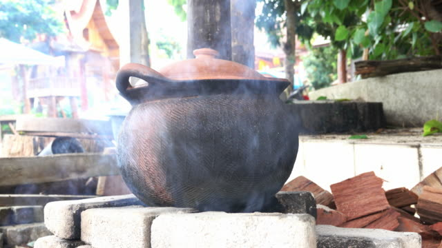 herb boiled in clay pot with smoke from fireplace - clay stock videos & royalty-free footage