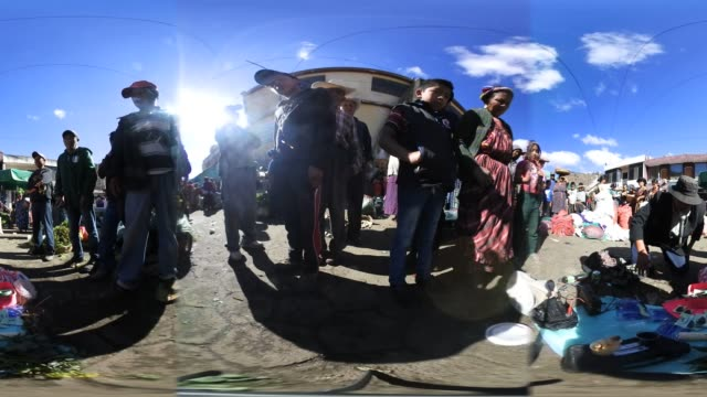 vídeos y material grabado en eventos de stock de herbal remedy salesman wilmer ruiz shows off his formula to people at a vegetable market on february 11 2017 in almolonga guatemala ruiz said he once... - mp4