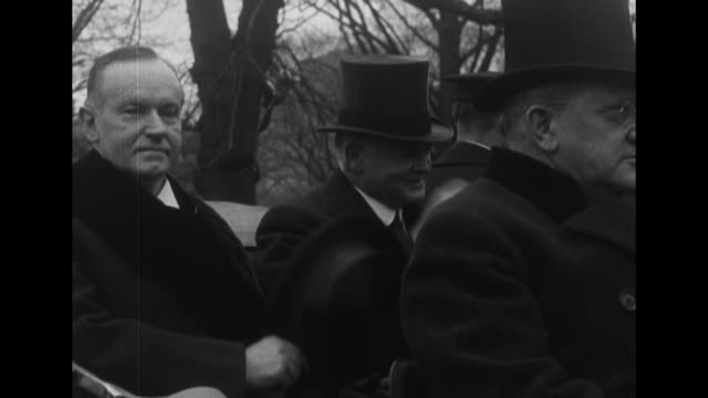 herbert and lou hoover in winter clothes are seated in a convertible car / calvin coolidge hoover leave the white house and enter another car man... - convertible top stock videos & royalty-free footage