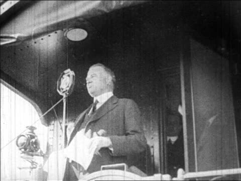 herbert hoover speaking into microphone on train caboose during campaign / newsreel - 1928 stock videos & royalty-free footage