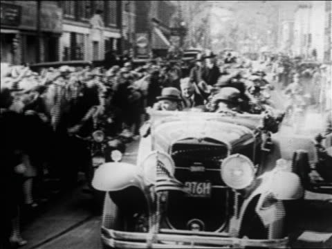 vídeos y material grabado en eventos de stock de herbert hoover standing in car during parade + waving on campaign trail / newsreel - 1928