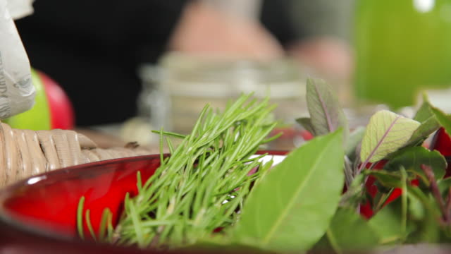 herbs and spices on a bowl - kräuter stock-videos und b-roll-filmmaterial