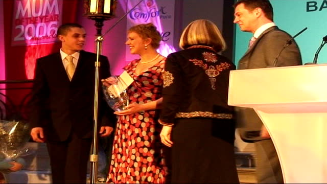 herceptin campaigner barbara clark breast cancer in remission; 15.1.2006 london: waldorf hotel: clark receiving 'mum of the year' award on stage... - ウォルドルフ・アストリア点の映像素材/bロール