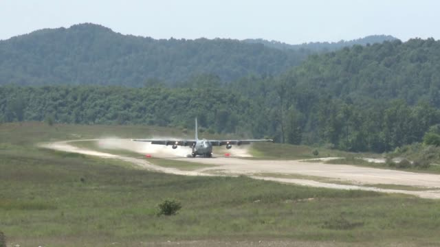 Hercules aircraft from Youngstown Air Reserve Station performs maneuvers at a dirt airstrip during a training mission at Camp Branch in Charleston...