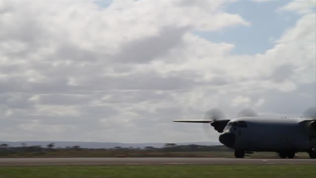 c-130j hercules cargo plane taking off, raaf, australia - cargo aeroplane stock videos & royalty-free footage