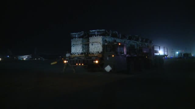 stockvideo's en b-roll-footage met hercules crew from the 774th expeditionary airlift squadron out of bagram airfield afghanistanairdrops supply bundles at night over ghazni province... - bagram air base