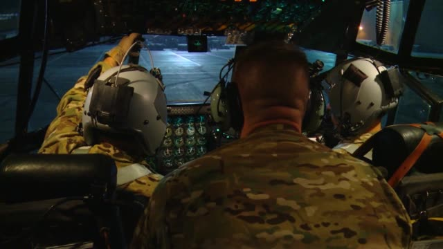 hercules crew from the 774th expeditionary airlift squadron out of bagram airfield, afghanistan,airdrops supply bundles at night over ghazni... - bagram stock videos & royalty-free footage