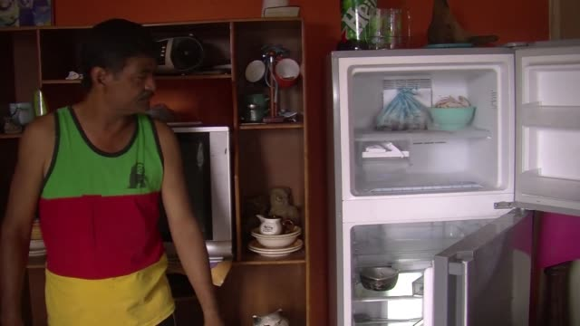 here we have breakfast not lunch or if we have lunch we don't have dinner a caracas slum resident tells afp as endemic food shortages continue to... - endemic stock videos and b-roll footage
