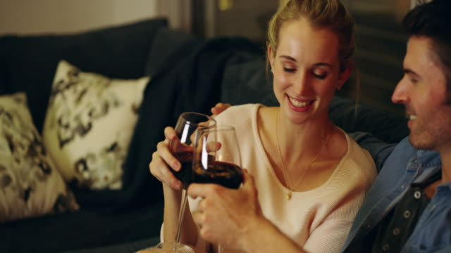 here's to many more romantic moments - living room stock videos & royalty-free footage