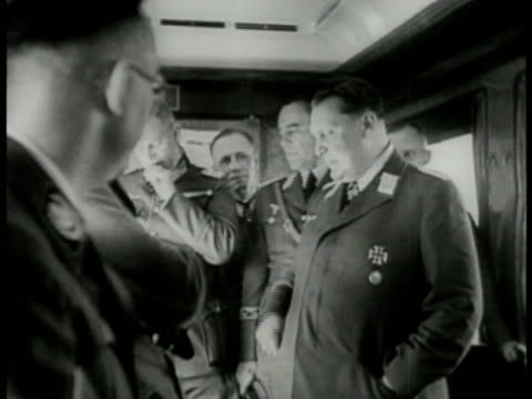 hermann goering standing gesturing at table other officers erwin rommel bg goering pointing at map heinrich himmler xfg pan hitler seated in chair... - hermann goering stock videos & royalty-free footage