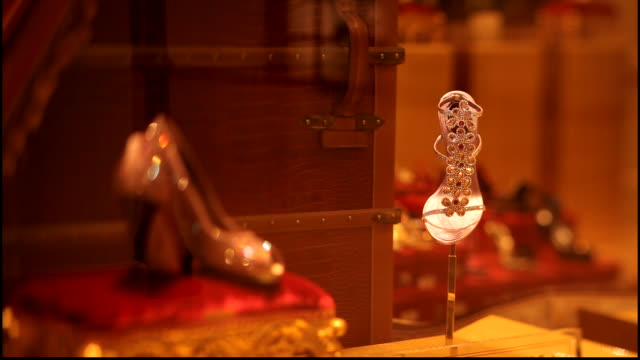 hermes boutique. rack-focus on crystal encrusted shoes and sandals in the hermes boutique shop window in doha. - crystal stock videos & royalty-free footage