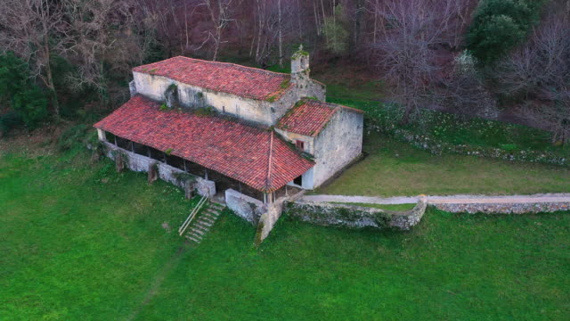 hermitage of san emeterio, landscape in the surroundings of the cave of the pindal, lighthouse and hermitage of san emeterio, cantabrian sea, asturias, spain, europe - wallfahrt stock-videos und b-roll-filmmaterial