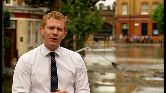 herne hill flooding caused by burst water main reporter to camera bruce grain interview sot - herne hill stock videos & royalty-free footage