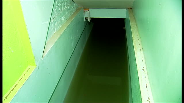 Herne Hill flooding caused by burst water main Submerged dental practice on flooded street Various of flooded basement steps Daniel Hopkins interview...