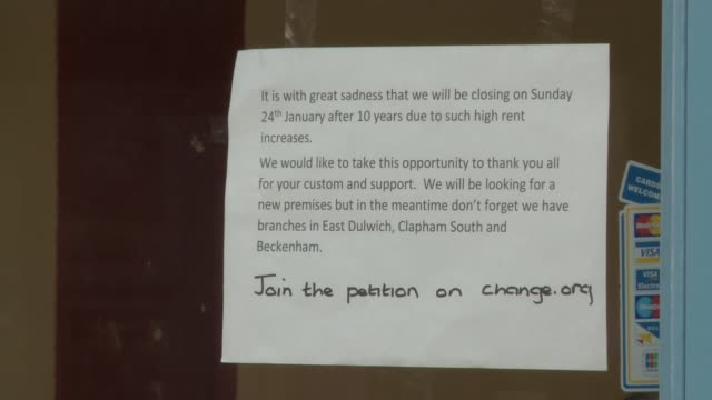 herne hill shop owners protest against rent hike notice in shop window announcing closure of shop due to high rent increases - herne hill stock videos & royalty-free footage