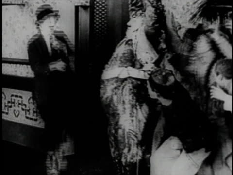 1920 montage hero and villains battling in restaurant  - larry semon stock videos and b-roll footage