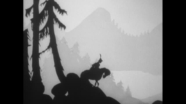 ts hero riding horse through woods and town / united kingdom - kamerafahrt auf schienen stock-videos und b-roll-filmmaterial
