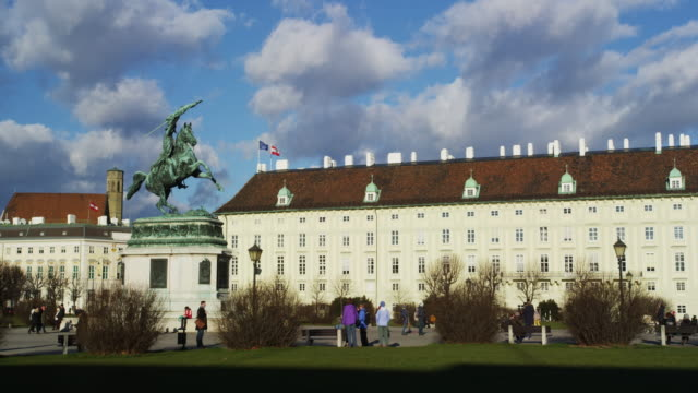 hero square with hofburg palace and the statue of archduke charles of austria - austria flag stock-videos und b-roll-filmmaterial