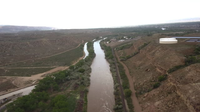 heroic drone view of the gunnison river near the grand junction with the colorado river - gunnison stock videos & royalty-free footage
