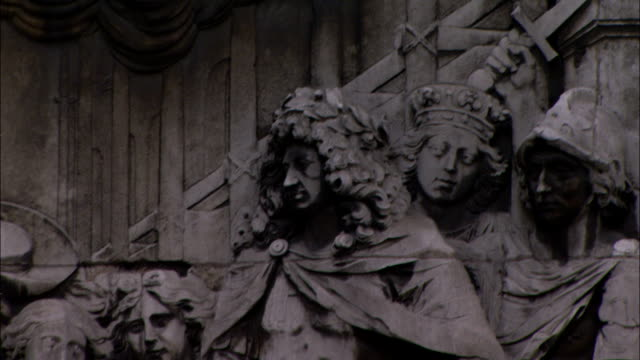 heroic sculptures decorate the pedestal of a london monument. - carving craft product stock videos & royalty-free footage