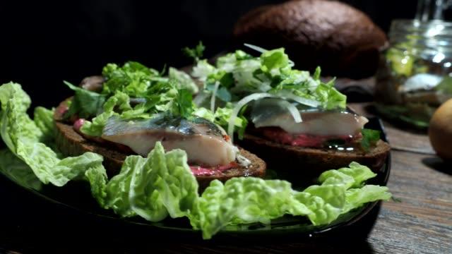 herring on toasts preparing - marinated stock videos & royalty-free footage
