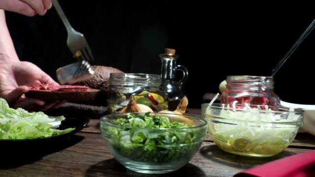herring on toasts preparing - gourmet stock videos and b-roll footage