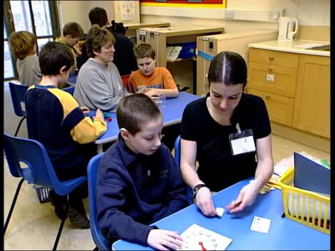 vídeos de stock, filmes e b-roll de hertfordshire ext seq autistic children playing in primary school playground int autistic children in classroom terri phillips interviewed sot... - primary age child