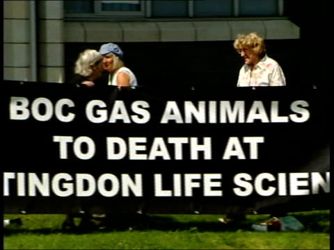 hertfordshire: ext tape recorder lying on grass in front of building playing sound of screaming terrified animal, with animal rights protest banner... - wrapped in a towel stock videos & royalty-free footage