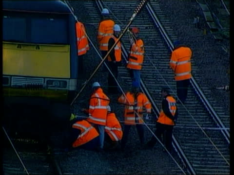 hatfield ext tgv derailed train carriages lying on tracks tlms rail workers around derailed train tgv derailed carriages tlms rail workers on tracks... - hatfield stock videos and b-roll footage