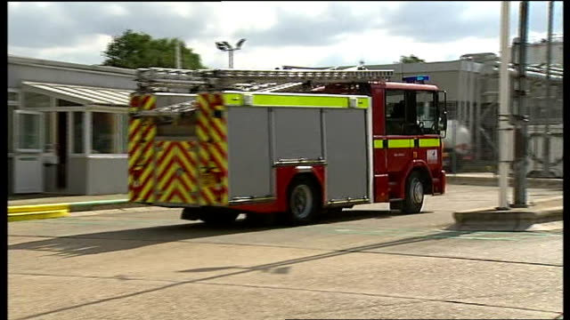 hertfordshire hemel hempstead buncefield oil depot ext emergency fire drill exercise fire engines arriving at buncefield site firefighters at oil... - fire drill stock videos & royalty-free footage