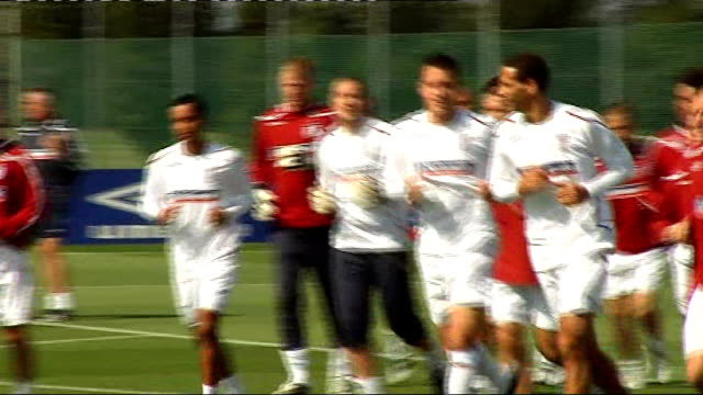 Hertfordshire London Colney EXT England footballers including David Beckham Rio Ferdinand and John Terry jogging on pitch during training session...