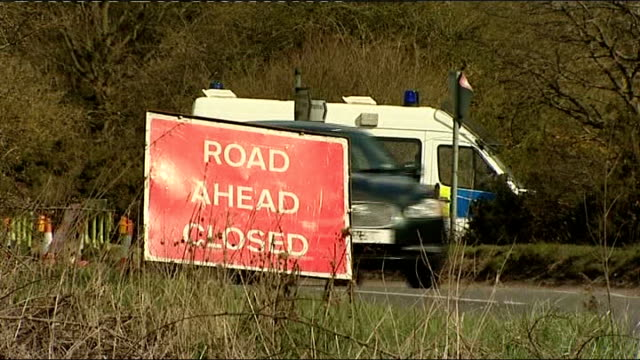 severed arm found; nr wheathampstead: ext 'road closed' sign at scene long shot of police officers and vehicles seen on far side of field police... - road closed englisches verkehrsschild stock-videos und b-roll-filmmaterial