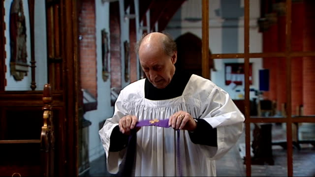 hertfordshire st albans int various of reverend roy day putting on vestments inside church reverend roy day interview sot reverend day lighting... - hernia stock videos and b-roll footage