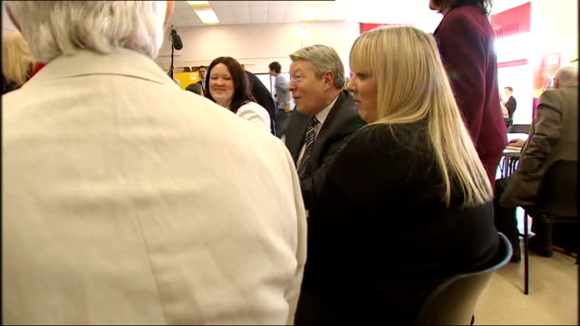 stevenage int linda bowman sitting next to alan johnson during visit to community centre gordon brown chatting to people at table including bowman... - stevenage stock videos and b-roll footage