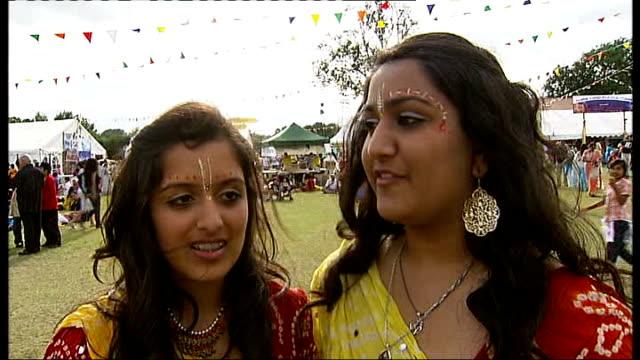 vídeos y material grabado en eventos de stock de hertfordshire watford ext vox pops visitors to krishna festival of janmashtami - krishna