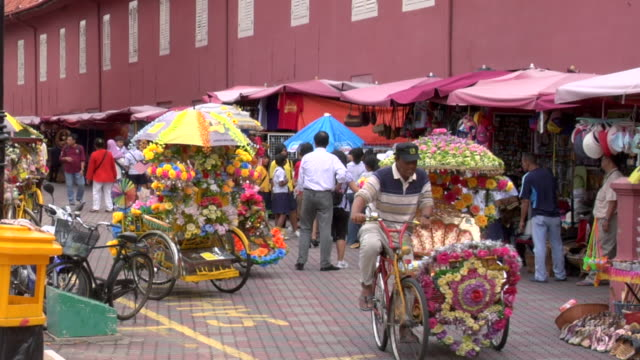 zi hertiage city richshaws in main square downtown  / malacca, malaysia - rickshaw stock videos and b-roll footage