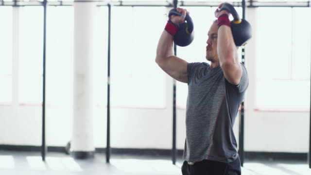 he's all about the lift - kettlebell stock videos & royalty-free footage