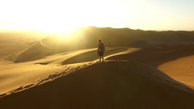 he's an adventurer at heart - namibian desert stock videos and b-roll footage